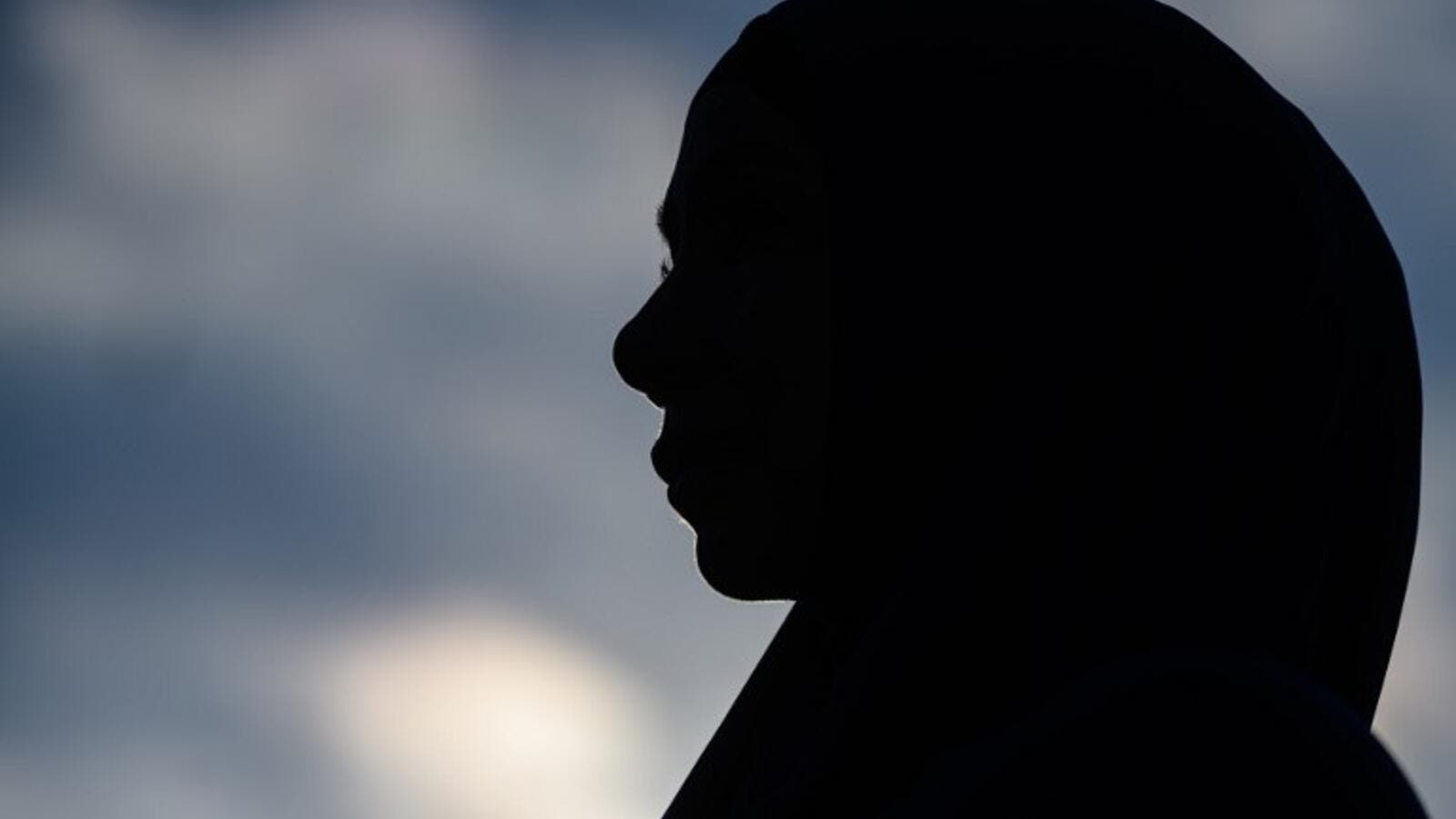 A woman attends a vigil in memory of the twin mosque massacre victims in Christchurch (AFP)