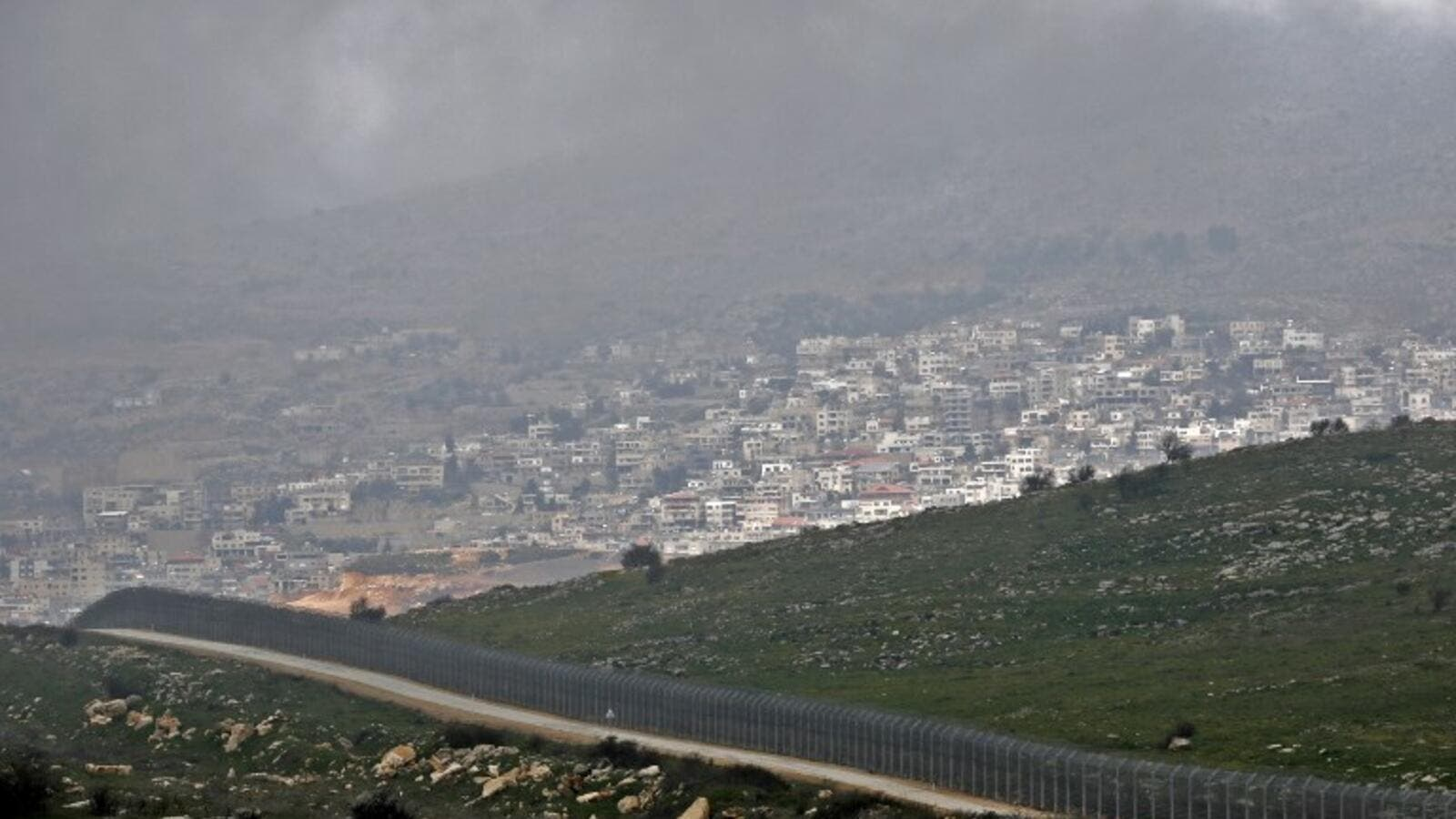 sraeli fence separating the Israeli-occupied sector of the Golan Heights near the Druze town (AFP)