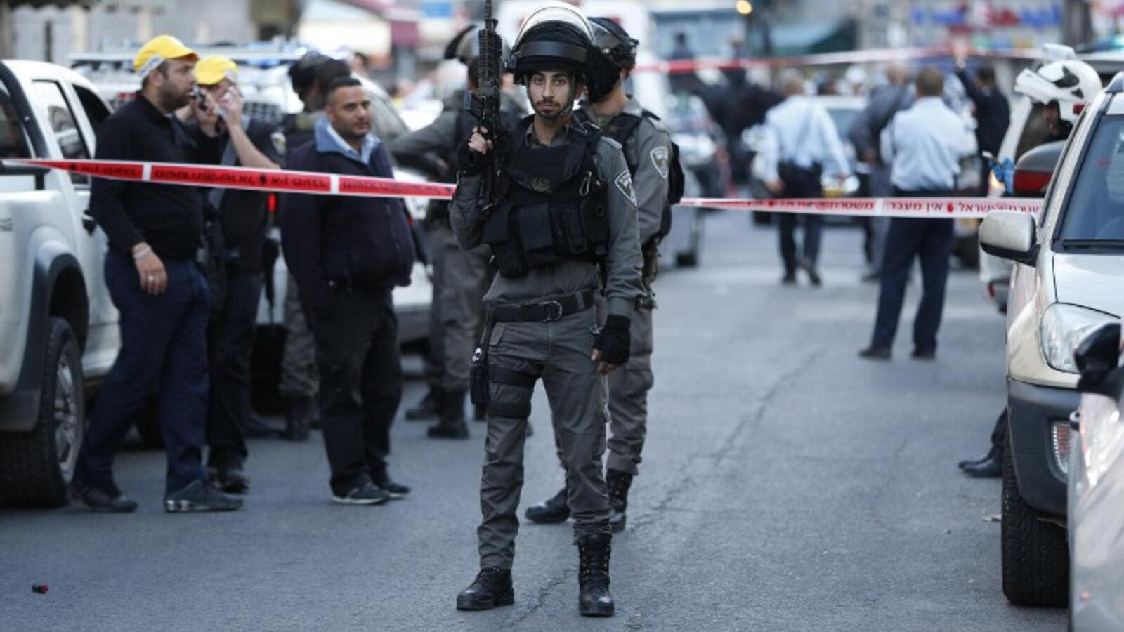 Israeli security forces seal off the area in Arab east Jerusalem's Salahedin street where a shooting attack took place on March 8, 2016. (AFP/Ahmad Gharabli)