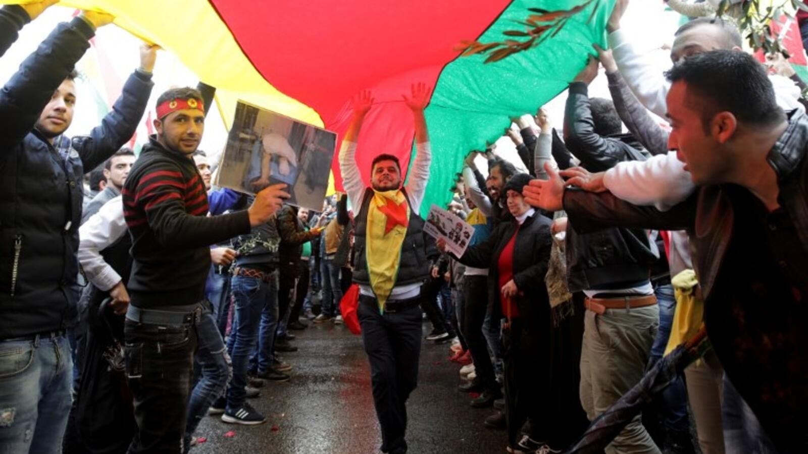 Lebanese Kurds wave flags and chant slogans on Jan. 28, 2018, during a protest near the European Commission offices in Beirut against the ongoing Turkish military campaign in the Kurdish-held Syrian enclave of Afrin (ANWAR AMRO / AFP)