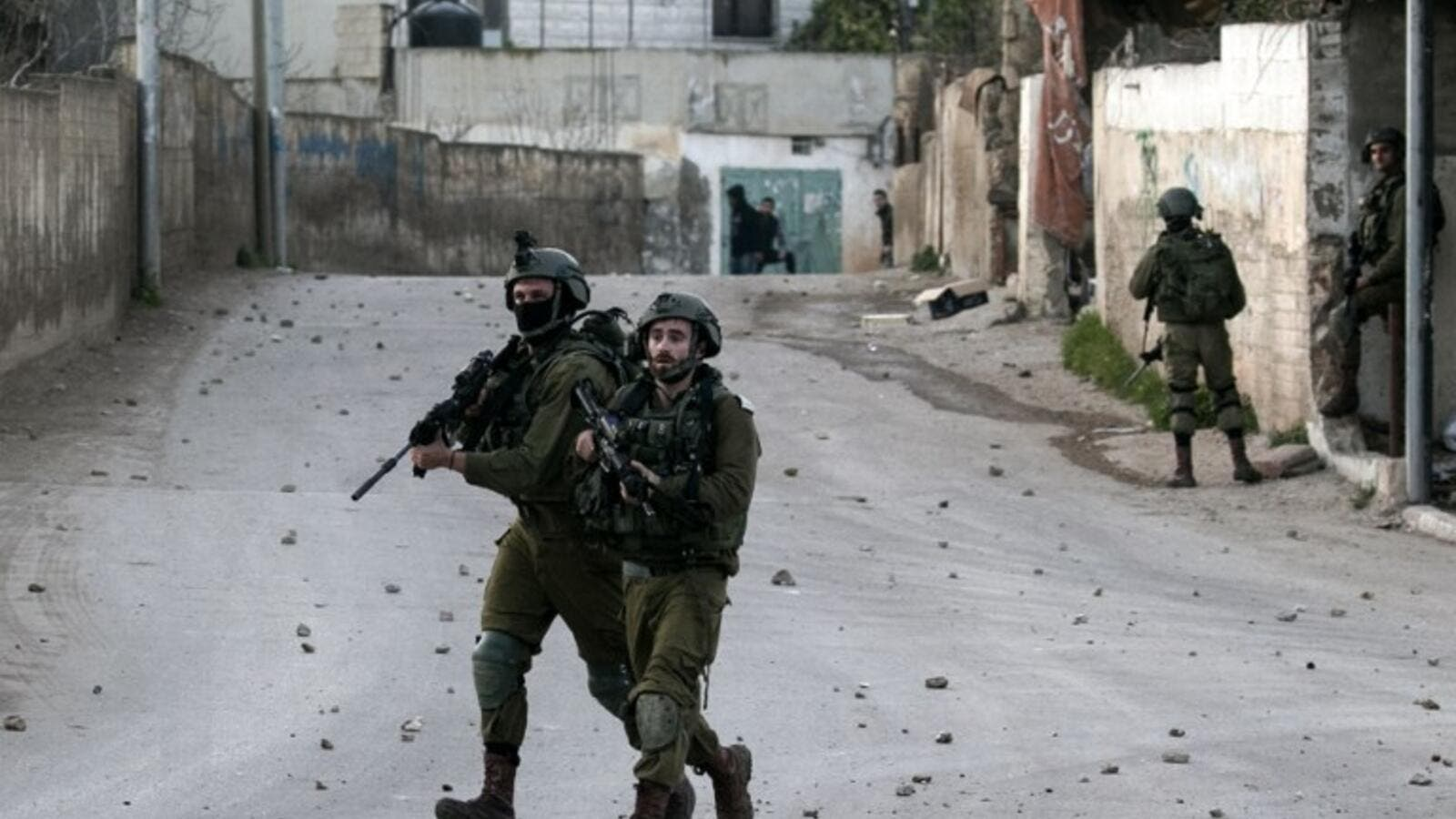 Israeli soldiers advance through the Palestinian village of Burqin in the northern occupied West Bank, during an army search operation on Feb. 3, 2018 (JAAFAR ASHTIYEH / AFP)