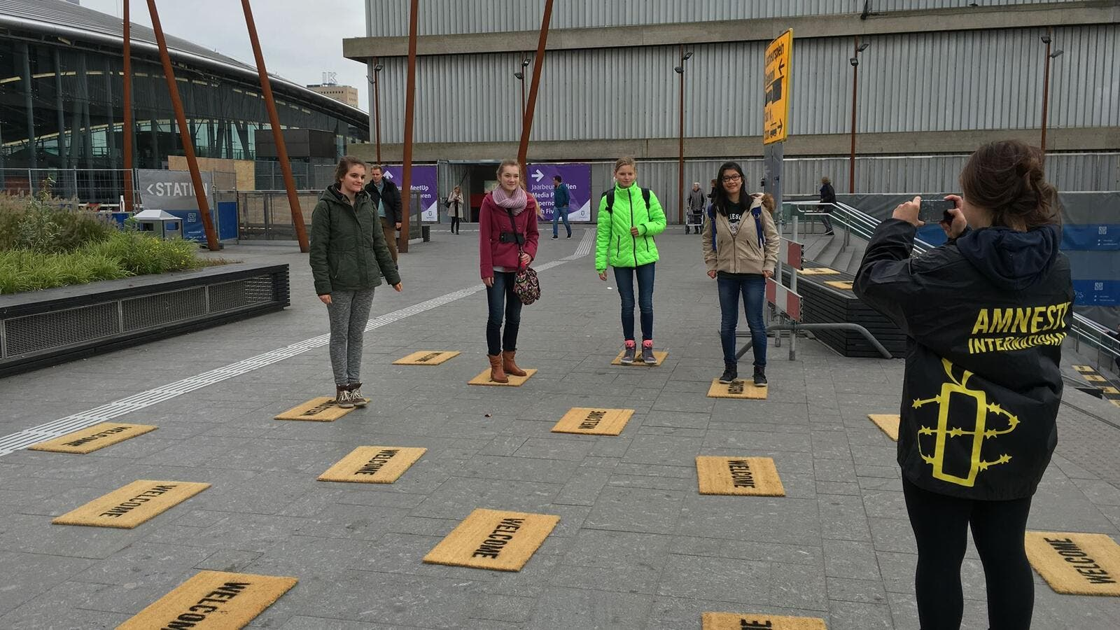 "Students lay down ""welcome"" door mats for Syrian refugees in Netherlands as part of the Utrecht Welcomes Refugees project for Amnesty International."