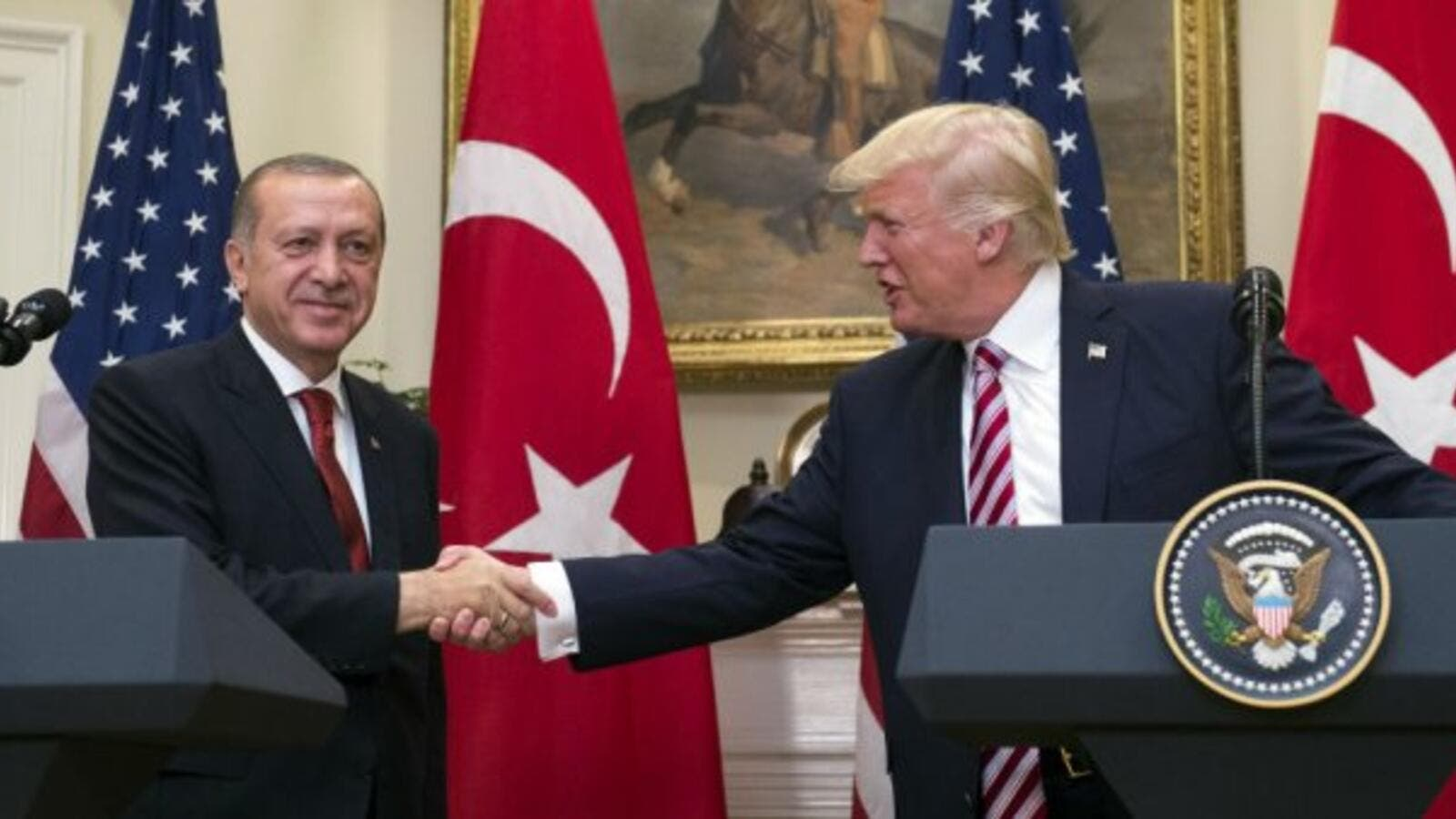 US President Donald Trump shakes hands with Turkish President Recep Tayyip Erdogan (AFP/File Photo)