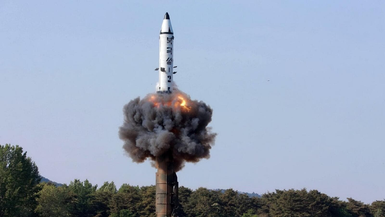 A North Korean ground-to-ground medium-to-long range strategic ballistic missile launches in a test-fire. North Korea on May 22 declared its medium-range Pukguksong-2 missile ready for deployment. (AFP/ File Photo)