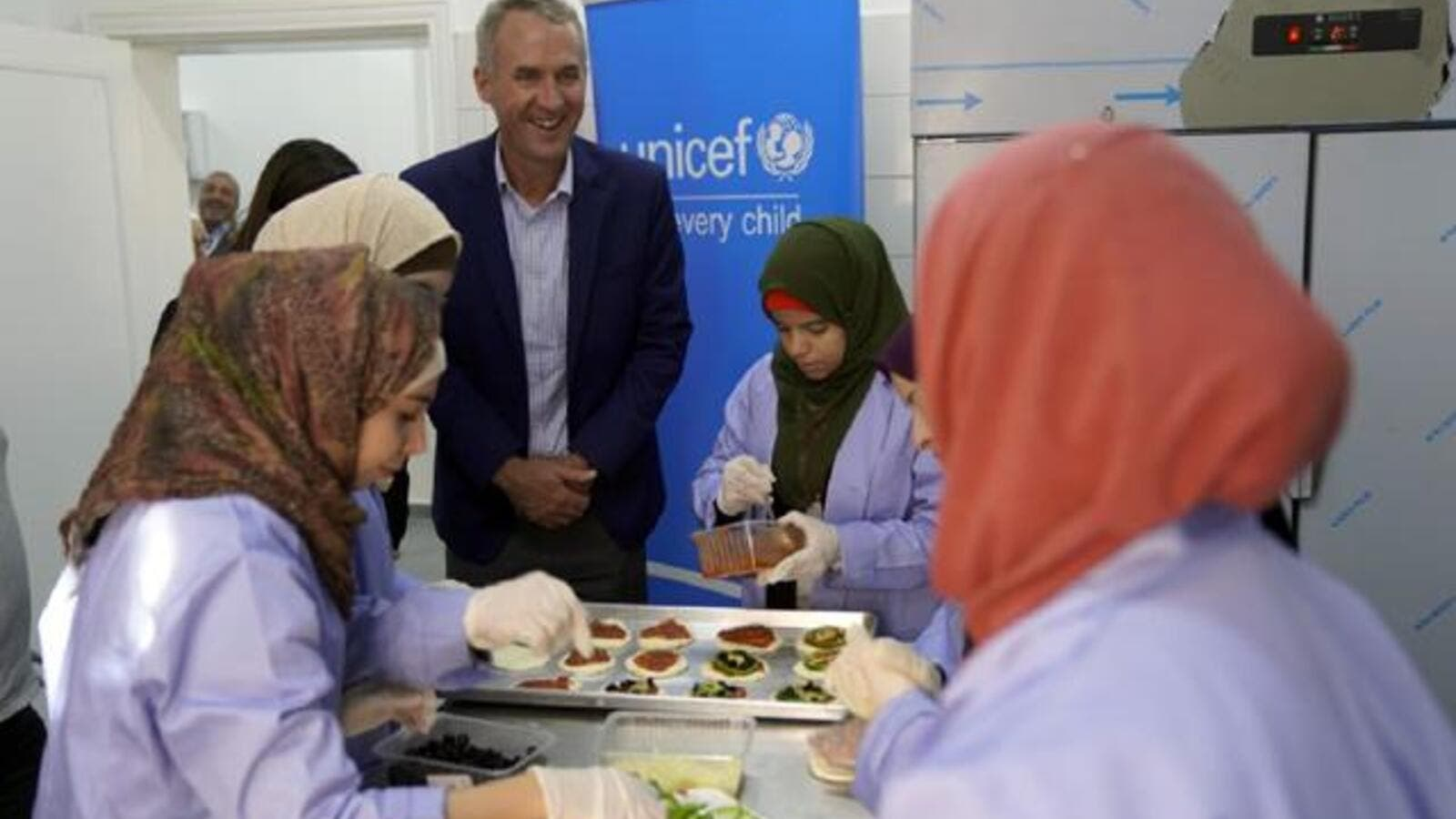 UNICEF Representative Robert Jenkins meets with women at the Al Dahmah Women's Association (Photo courtesy of UNICEF)
