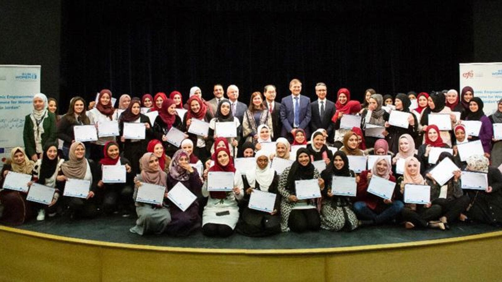 Graduates of a women's vocational training programme pose for a photo with their certificates on Thursday (Photo courtesy of UN Women)