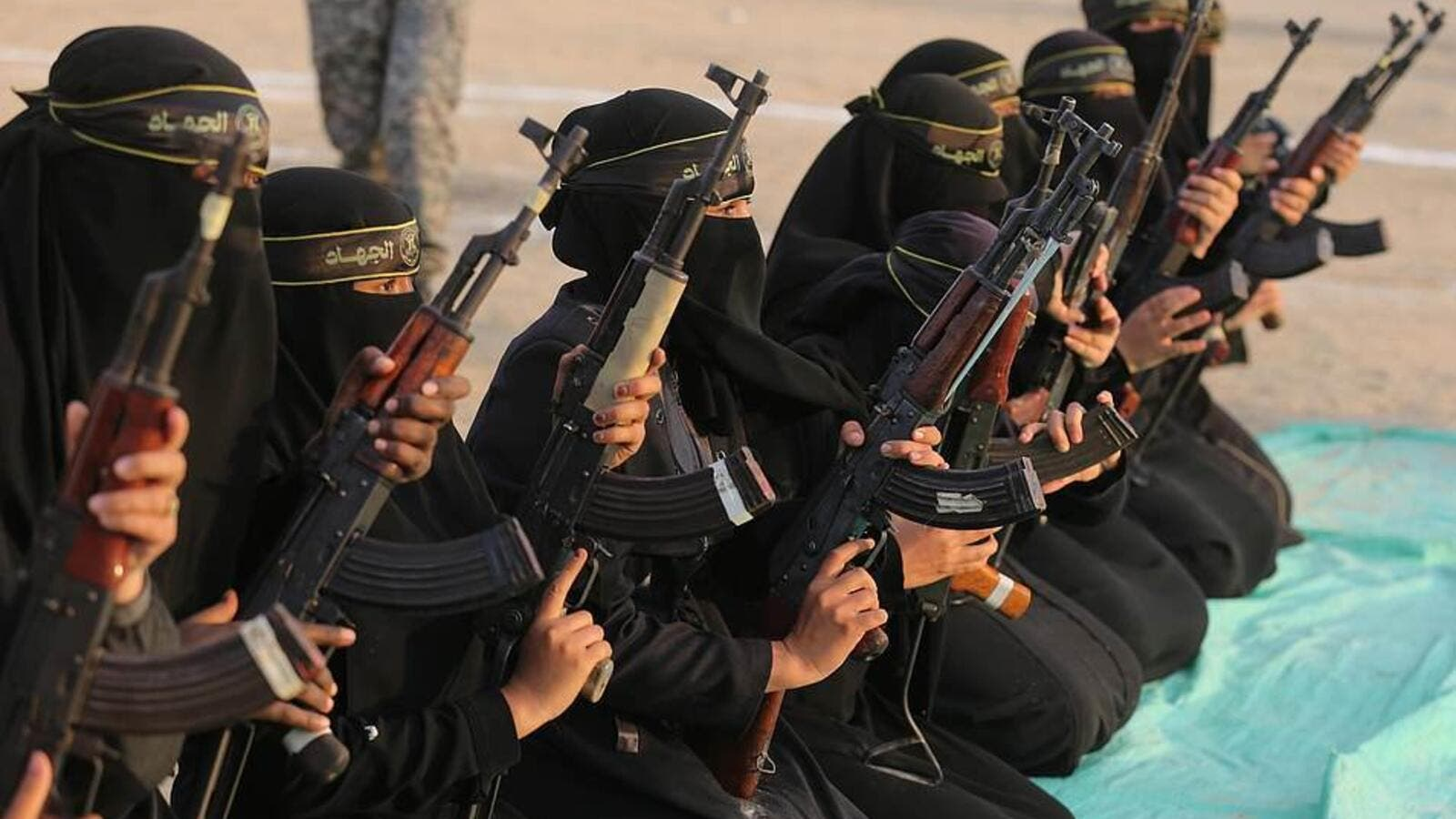 The women of the al-Quds Brigades holding Kalashnikov rifles and poised for action during the exercise at Khan Yunis on the southern section of the Gaza Strip (Shutterstock)