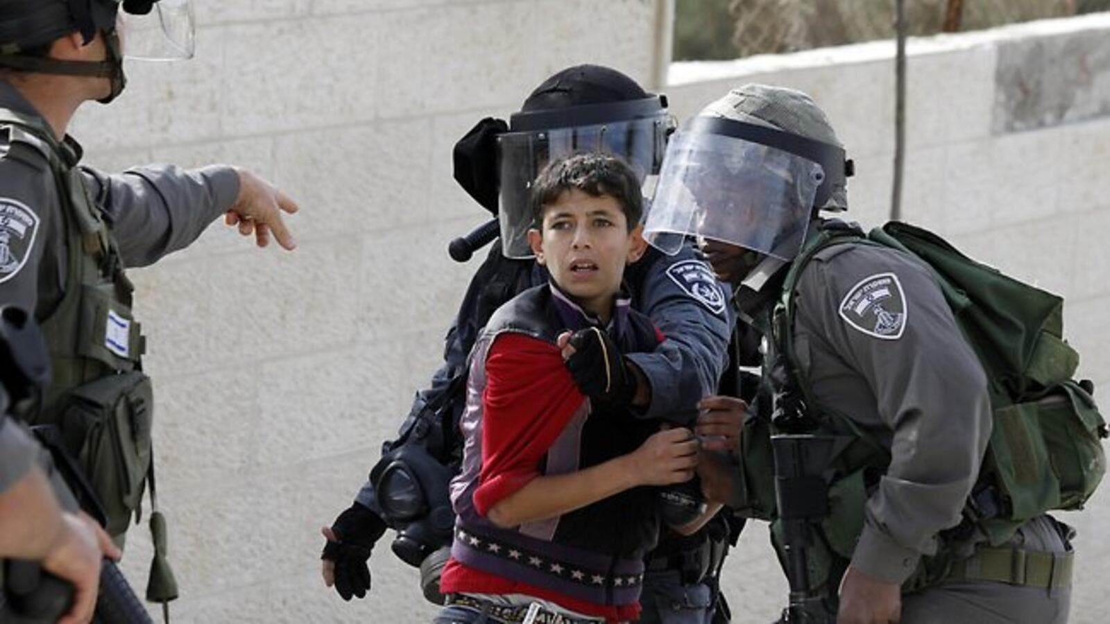 Israeli soldiers detain a Palestinian youth during protests in the West Bank. (AFP/File)