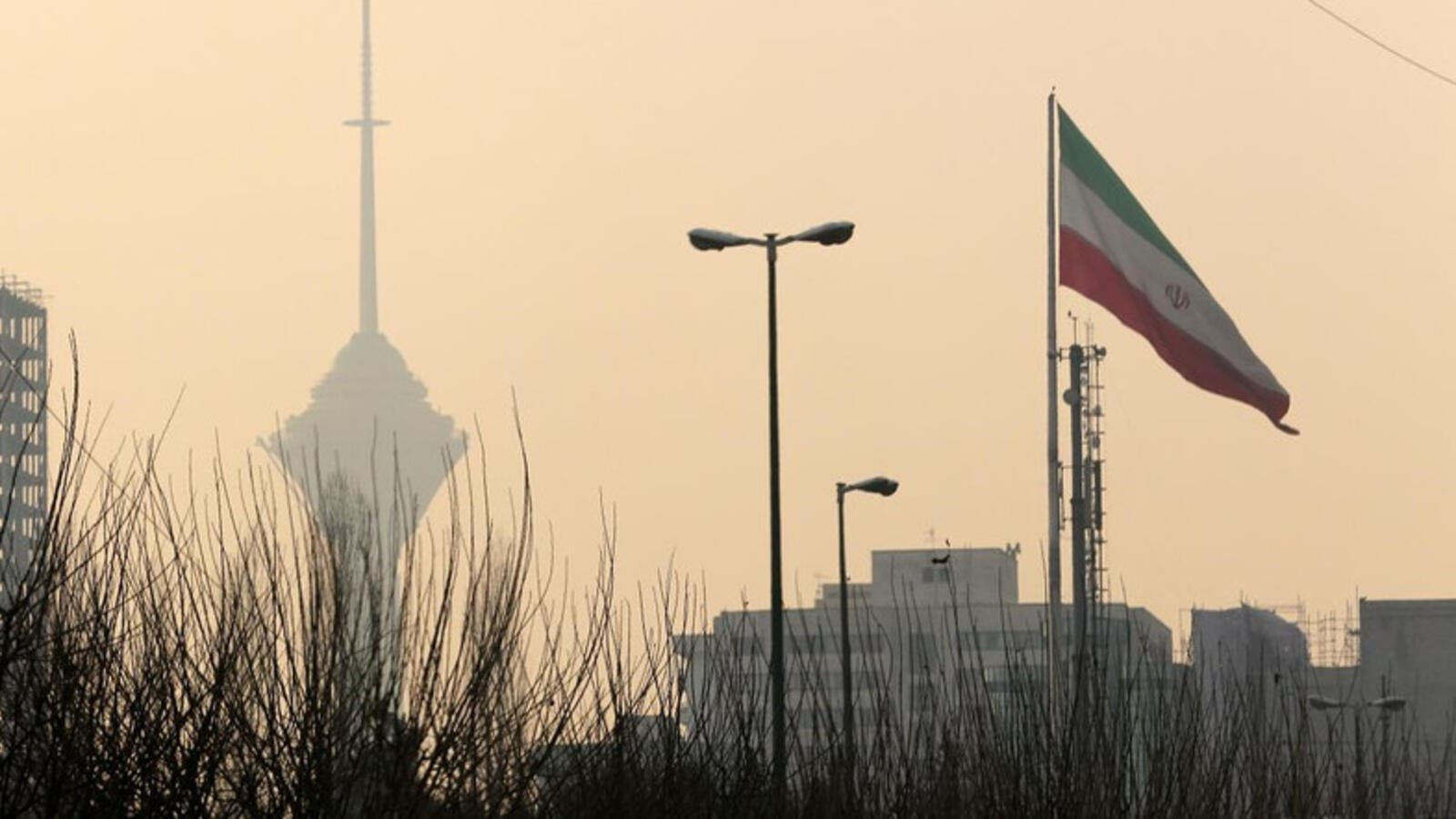 A general view of the Milad telecommunication tower engulfed by smog in the Iranian capital Tehran (AFP/File Photo)