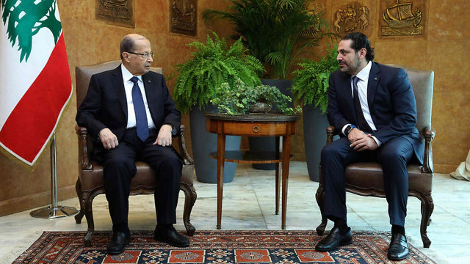 Lebanon President Michel Aoun (L) with Saad al-Hariri. (AFP/ File Photo)