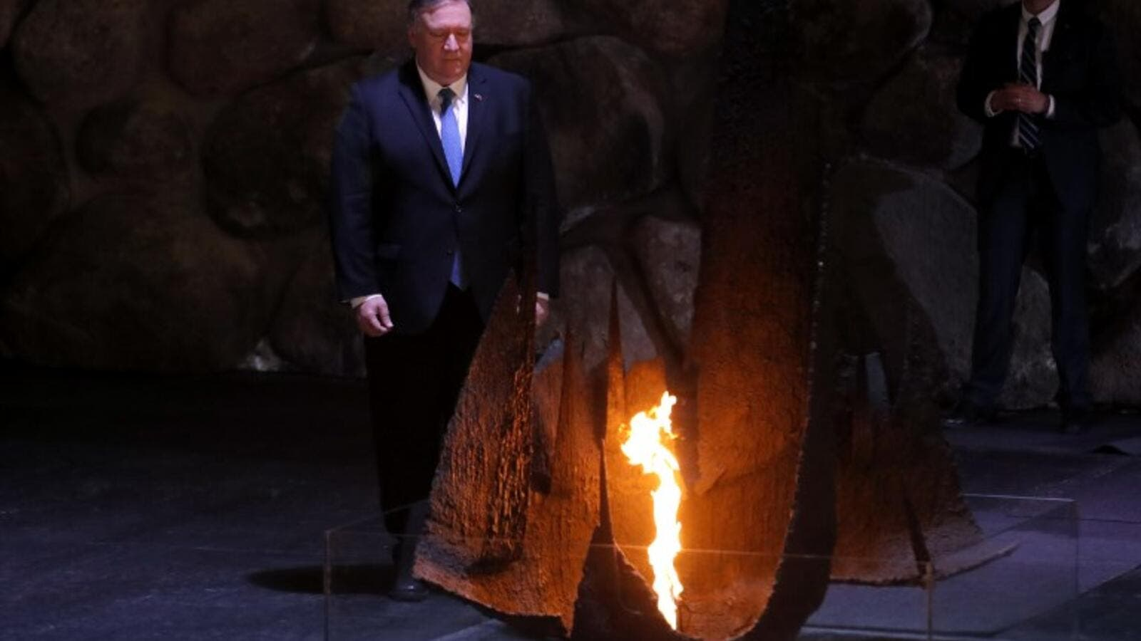 US Secretary of State Mike Pompeo stands next to the eternal flame at a ceremony commemorating the six million Jews killed by the Nazis during the Holocaus (AFP)
