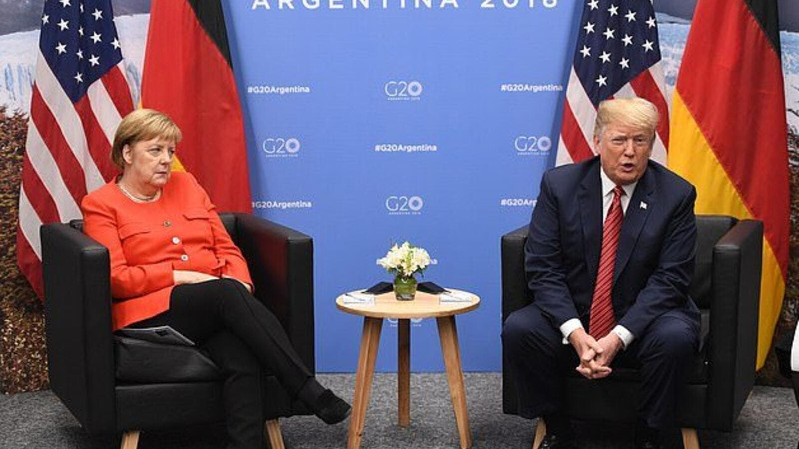 Angela Merkel looks less than impressed with Donald Trump during a meeting at the G20 Summit in Buenos Aires (AFP)