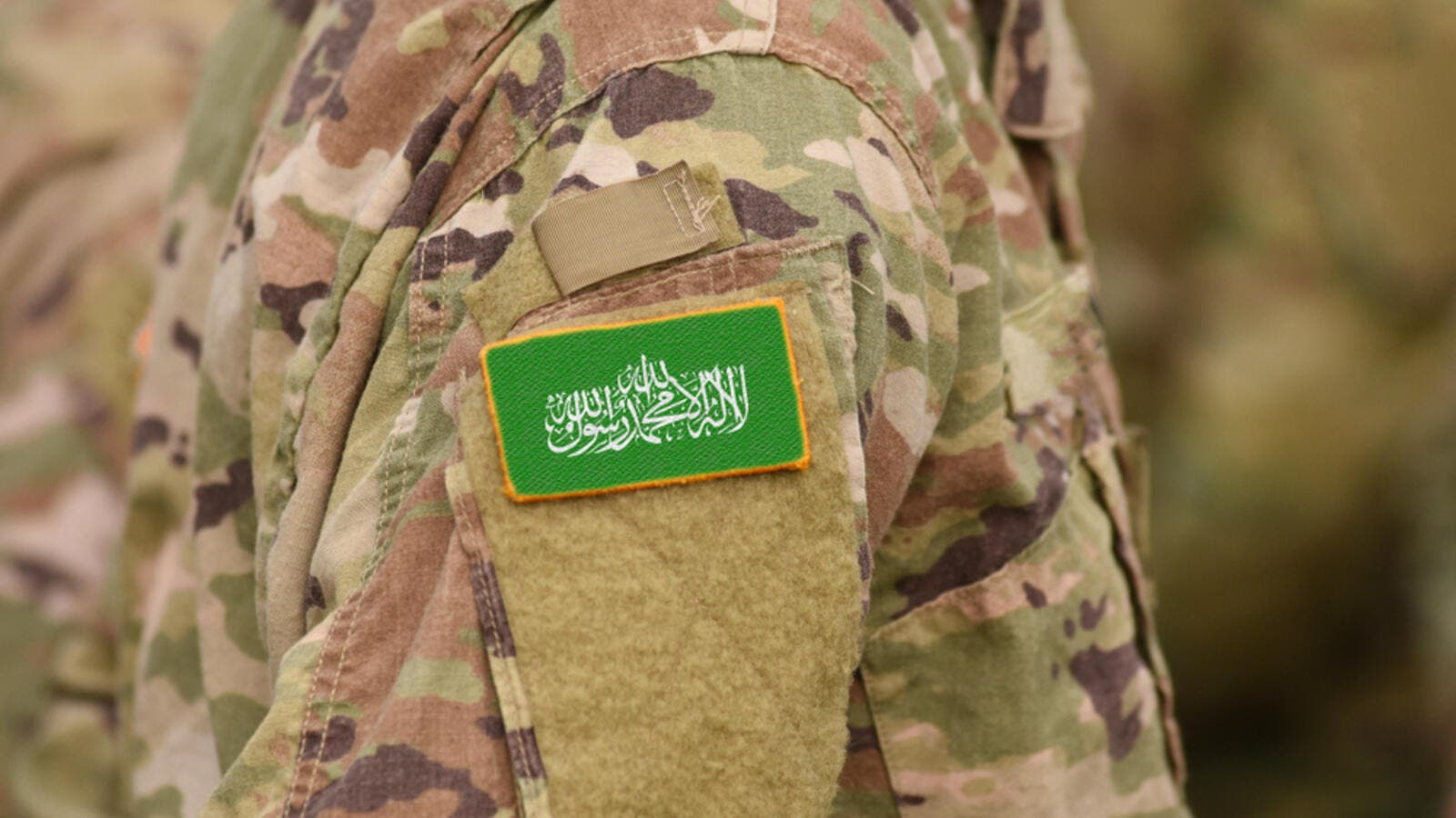 Flag of Hamas on soldier arm (Shutterstock)