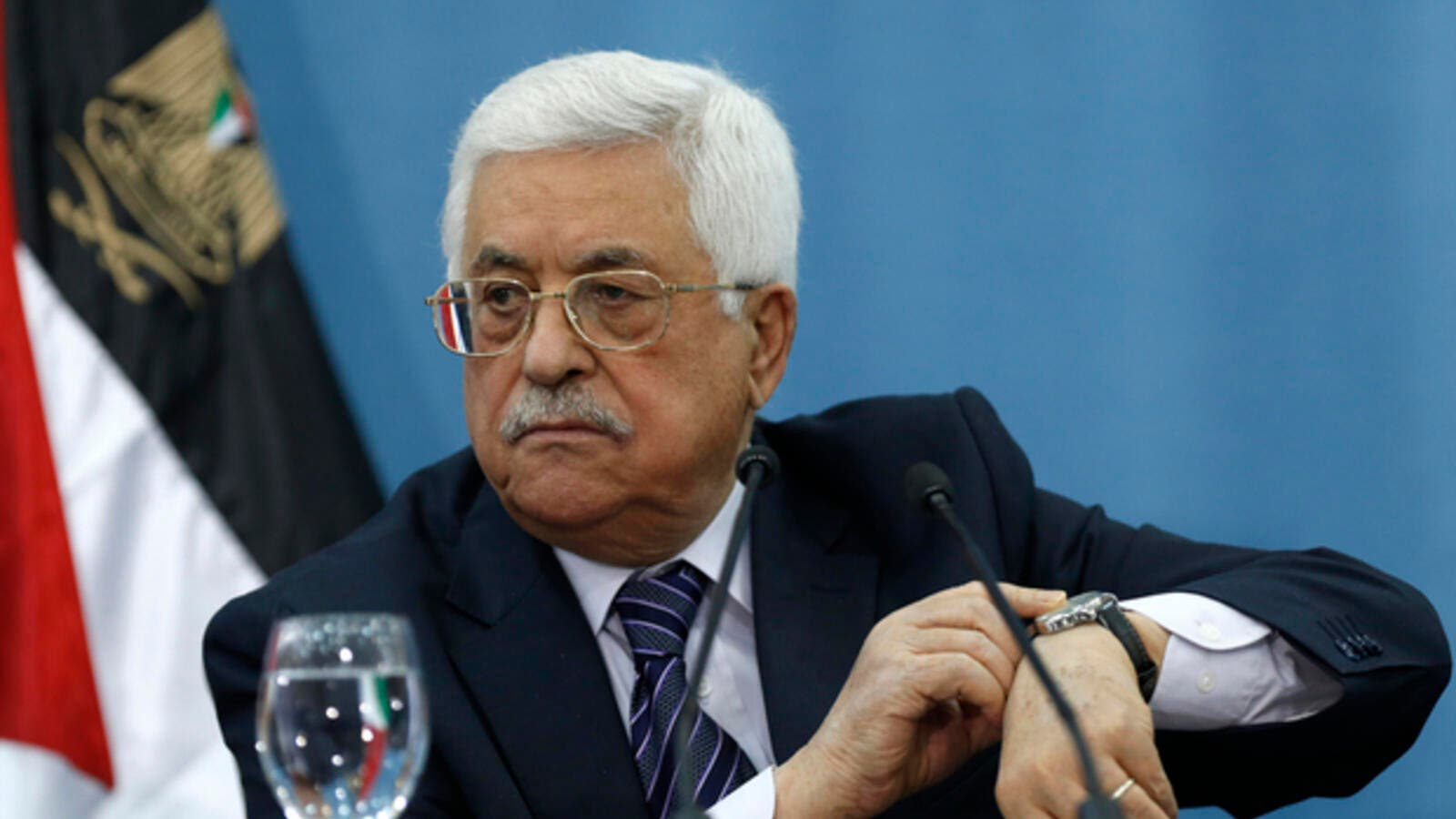 Palestinian Authority President Mahmoud Abbas gestures at his watch. (AFP/File photo)