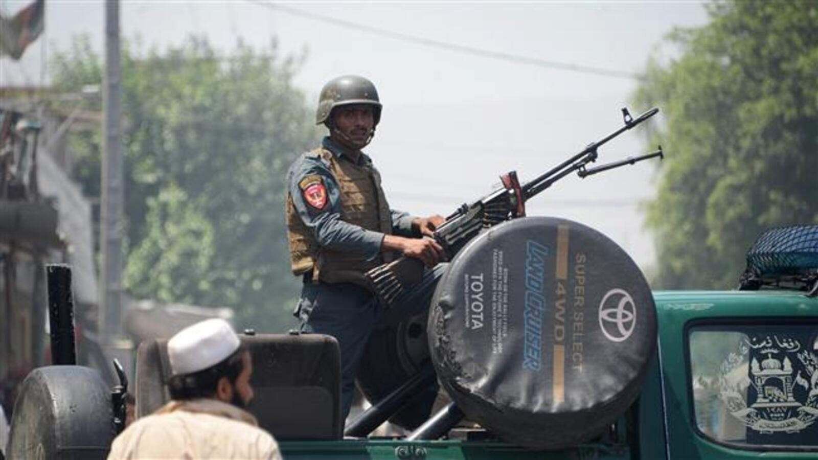 An Afghan soldier stands guard atop a vehicle near the site of an attack in Jalalabad on July 31, 2018. (AFP/ File photo)