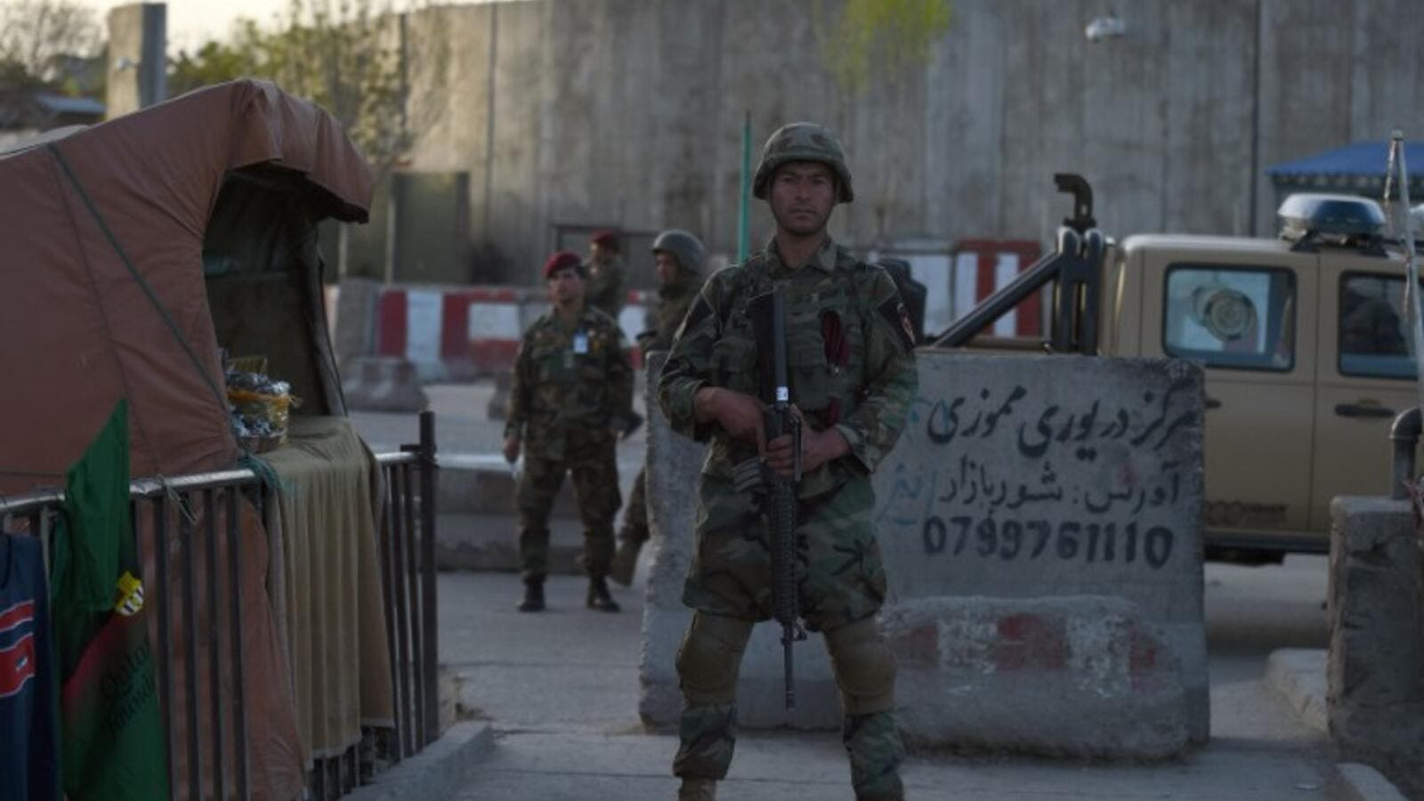 Afghan security personnel stand guard at the site of a suicide attack near the Ministry of Defense in Kabul on April 12, 2017. (AFP/Wakil Kohsar)