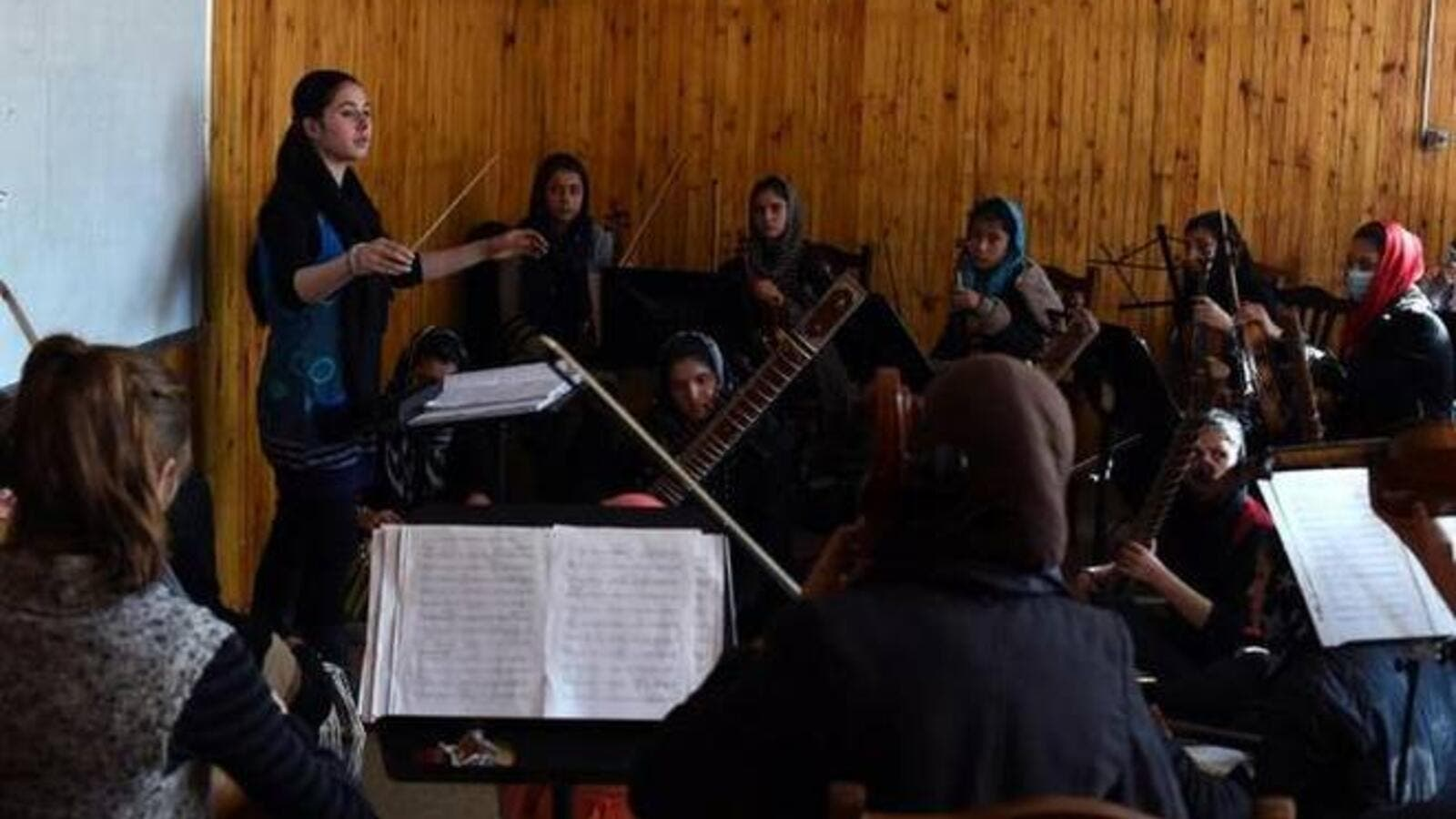 In this January 8, 2017 photo, Negina Khpalwak (19), the first female orchestra conductor in Afghanistan, is seen during a rehearsal at the National Institute of Music in Kabul. (AFP/File)