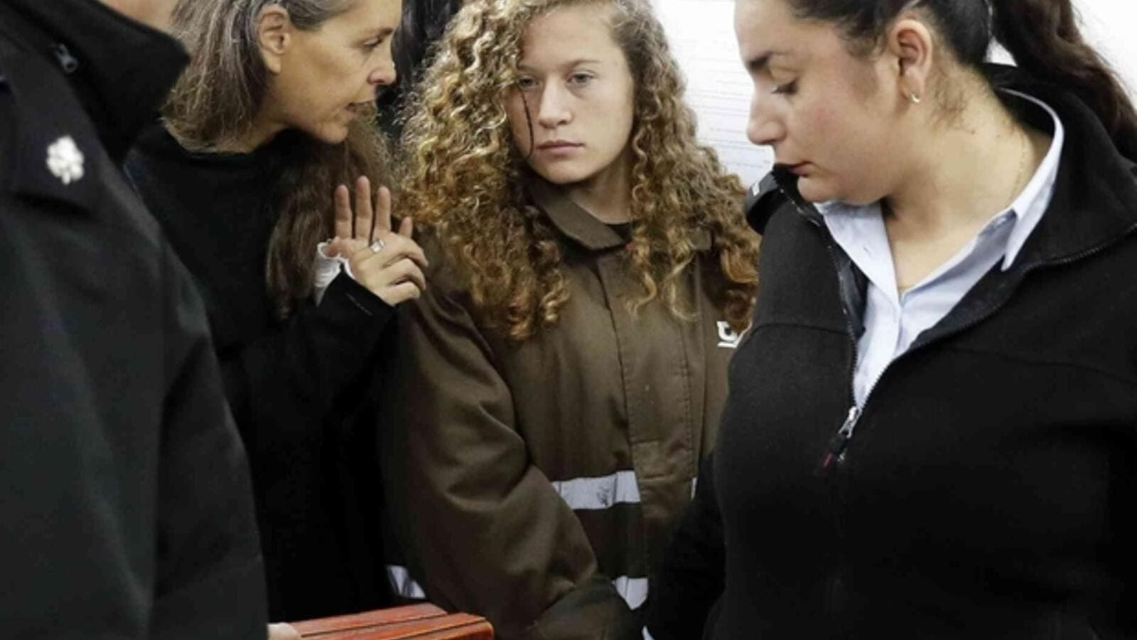 Israeli lawyer Gaby Lasky speaks with Ahed Tamimi, her client (AFP/File Photo)
