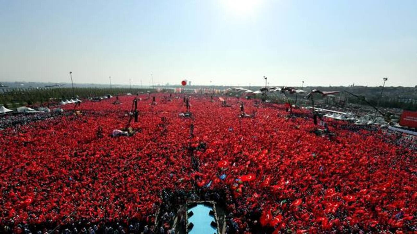 People waving Turkish national flags as they gather on at Yenikapi in Istanbul during a rally against failed military coup on July 15.  (AFP/File)