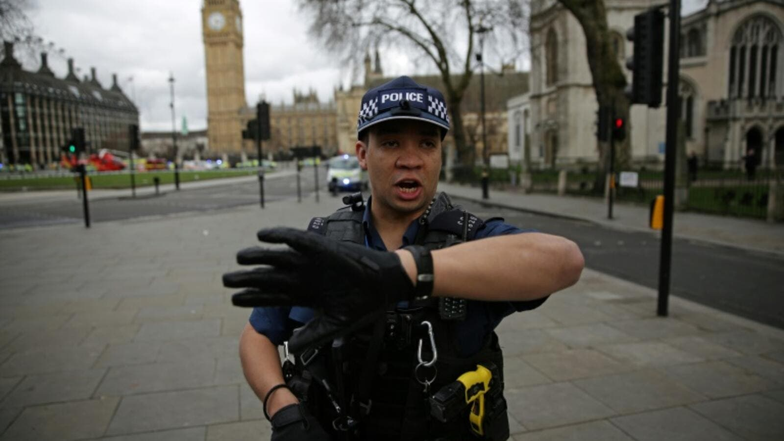An armed police officer stands guard in Parliament Square, opposite the Houses of Parliament in central London. (AFP/Daniel Leal-Olivas)