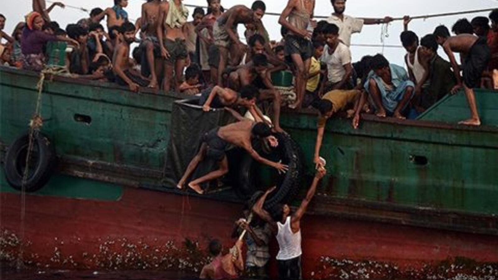Rohingya stranded off the coast of Thailand in May. (Christophe Archambault/ AFP)