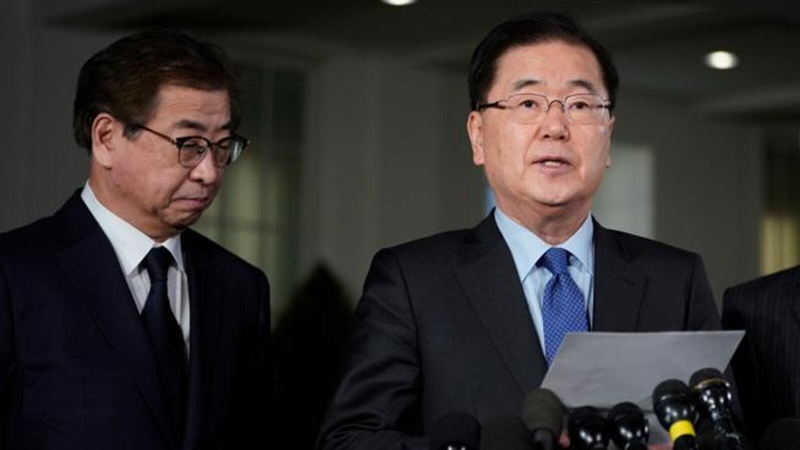 South Korean National Security Advisor Chung Eui-yong, right, briefs reporters outside the West Wing of the White House in Washington. (AFP/ File)