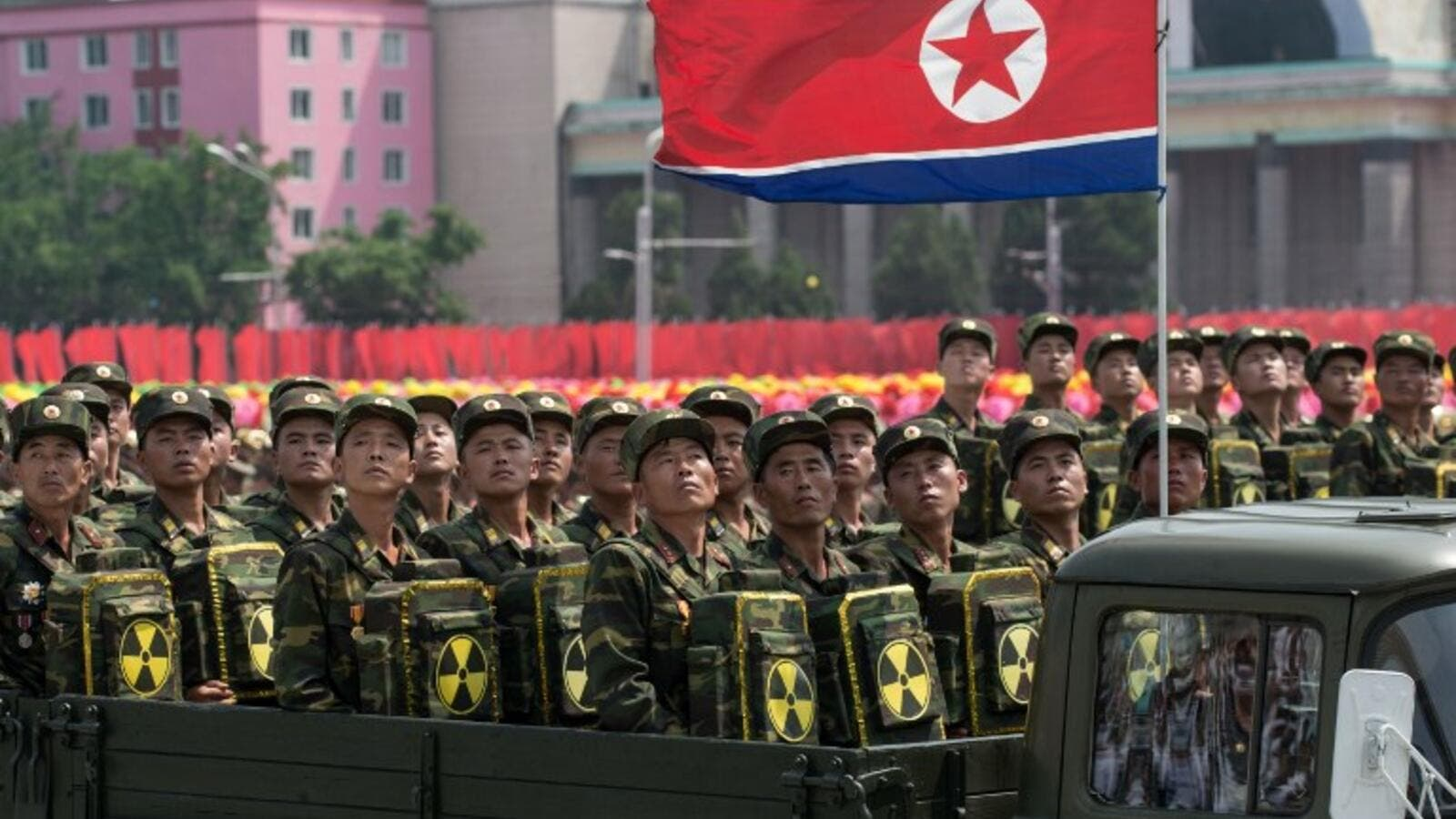 In this photo taken on July 27, 2013, Korean People's Army (KPA) soldiers carrying packs marked with a radioactive symbol take part in a military parade in Pyongyang (Ed Jones/AFP)