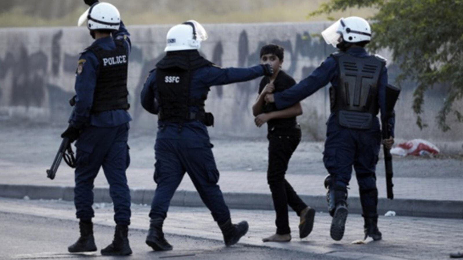 A Bahraini boy is arrested during clashes with riot police in the village of Daih, west of Manama on 19 June, 2014. (AFP)