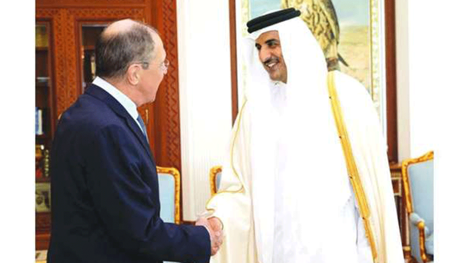 His Highness the Amir Sheikh Tamim bin Hamad al-Thani at his Amiri Diwan Office shakes hand with Russian Foreign Minister Sergey Lavrov. (Gulf Times)
