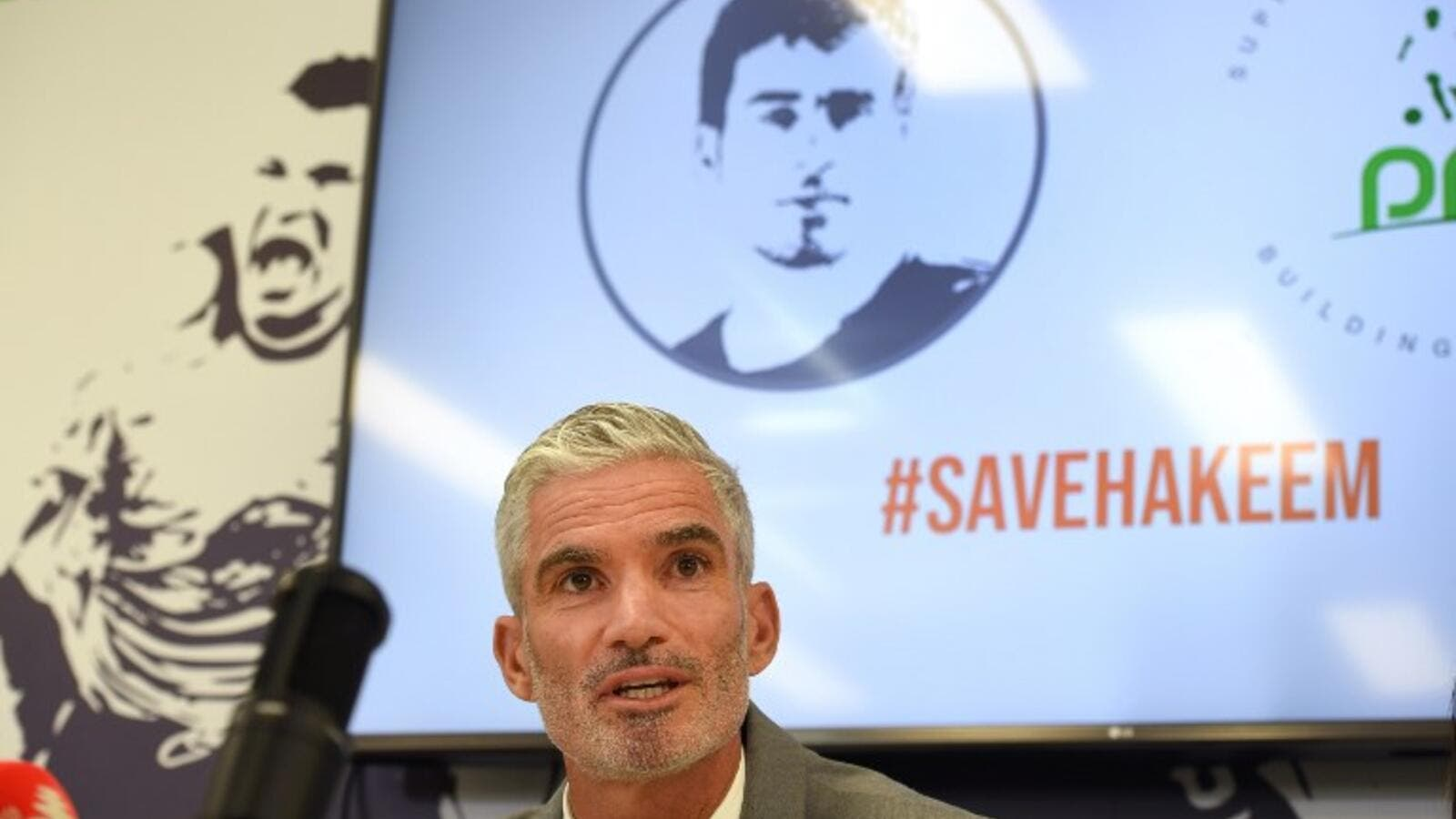 Former Australian football captain Craig Foster speaks during a press conference calling for the release of former Bahrain national footballer Hakeem Alaraibi from a Thailand detention centre