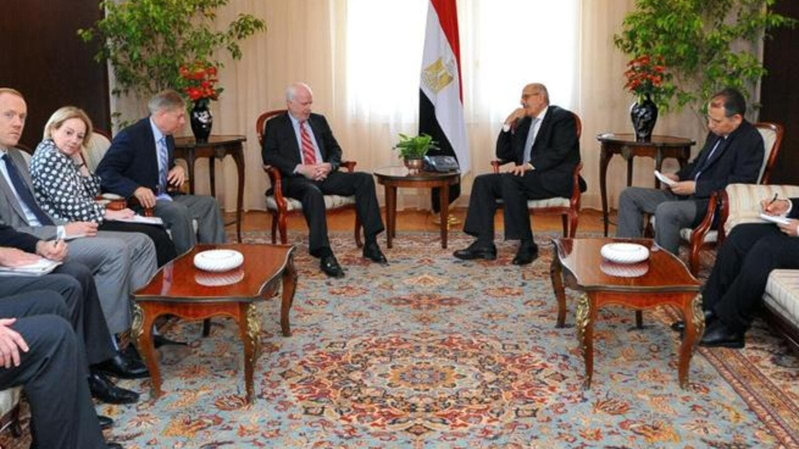 "EGYPT, Cairo : A handout picture made available by the Egyptian presidency on August 6, 2013, shows Egypt's Vice President Mohamed ElBaradei holding talks with the US Senator John McCain on August 6, 2013 in Cairo. ""AFP PHOTO / HO /EGYPTIAN PRESIDENCY """