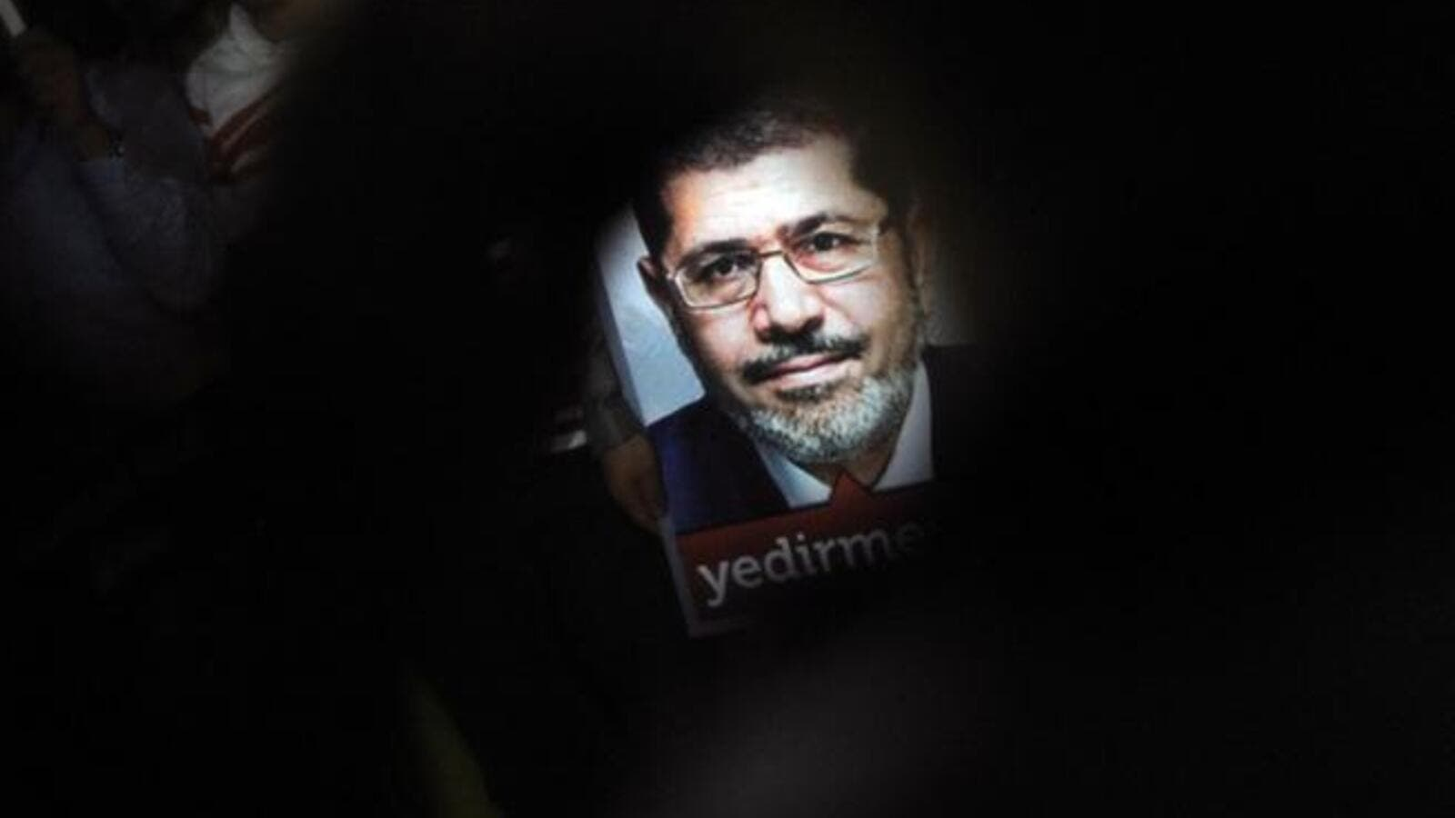 A poster of Egypt's President Mohammed Morsi is seen during a pro-Morsi demonstration on July 1, 2013 in Istanbul (Ozan Kose / AFP)