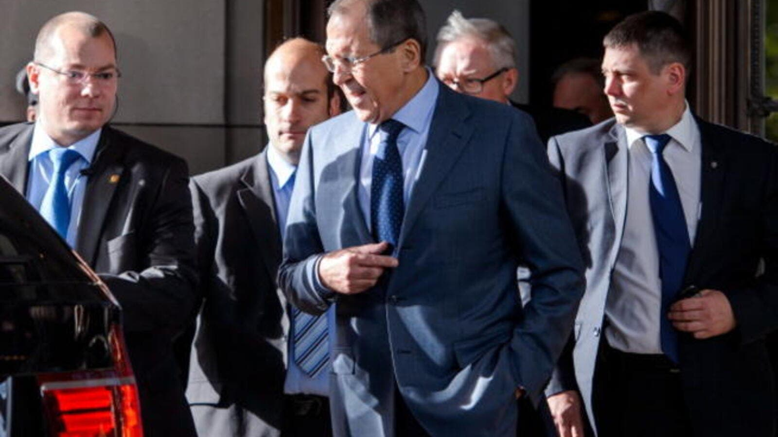 Russian Foreign Minister Sergei Lavrov leaves the Intercontinental Hotel on the third day of talks on Iran's nuclear program, on November 9, 2013 in Geneva.[AFP]