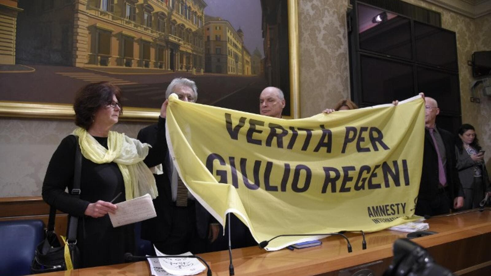The parents of Italian student Giulio Regeni hold a banner reading ''Truth for Giulio Regeni'' during a press conference in Rome March 29, 2016.  (AFP/Andreas Solaro)