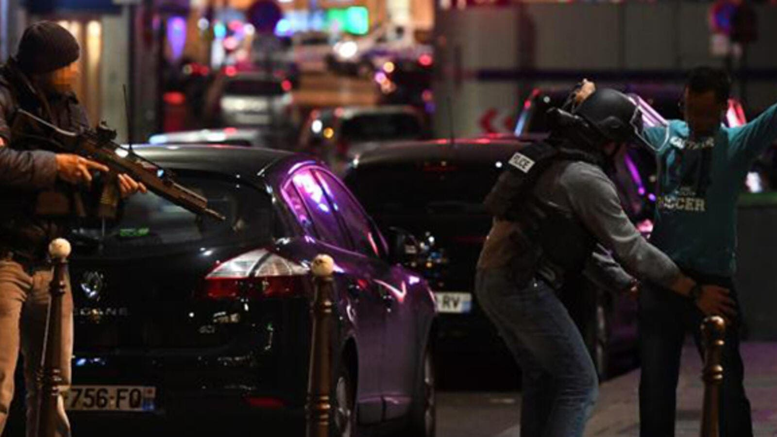 Police officers frisk a man on the Champs Elysees in Paris after the deadly shooting. (AFP)