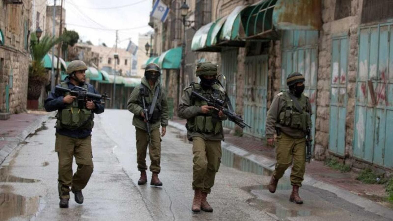 IDF soldiers seen on patrol in Hebron in the West Bank. (AFP/File)