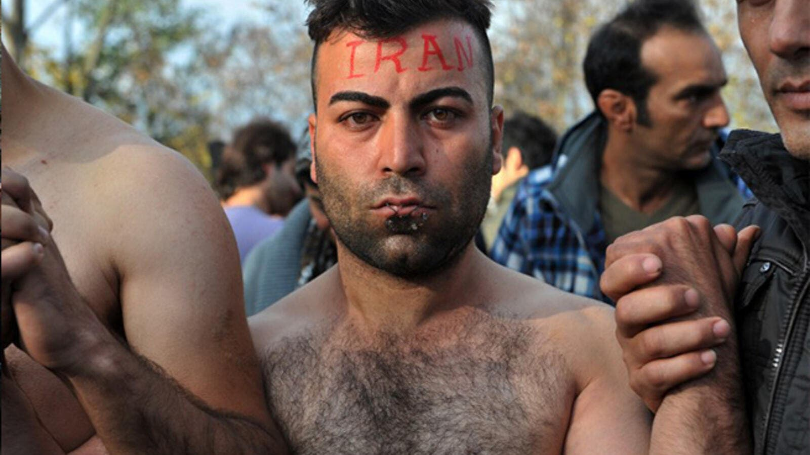 Scenes from inside the chaotic Macedonia-Greek border show Iranians and Kurds protesting their blocked entry—with needle and nylon. (AFP/File)