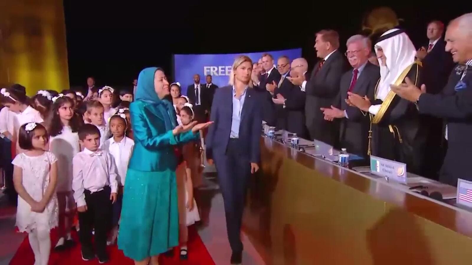 "NCRI ""President-elect"" Maryam Rajavi greets international speakers as she arrives at the ""gathering for a free Iran"" on July 1."