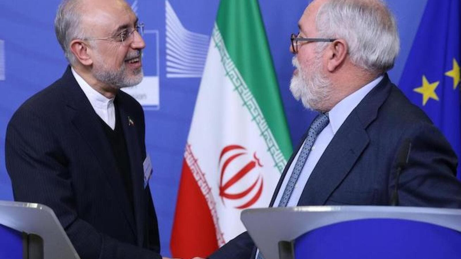 Miguel Arias Canete (R), Commissioner of the European Commission in charge of Climate Action and Energy, and Vice-President of the Islamic Republic of Iran and Head of the Atomic Energy Organisation of Iran (AEOI), Ali Akbar Salehi shake hands during a joint press point in Brussels on November 26, 2018. AFP