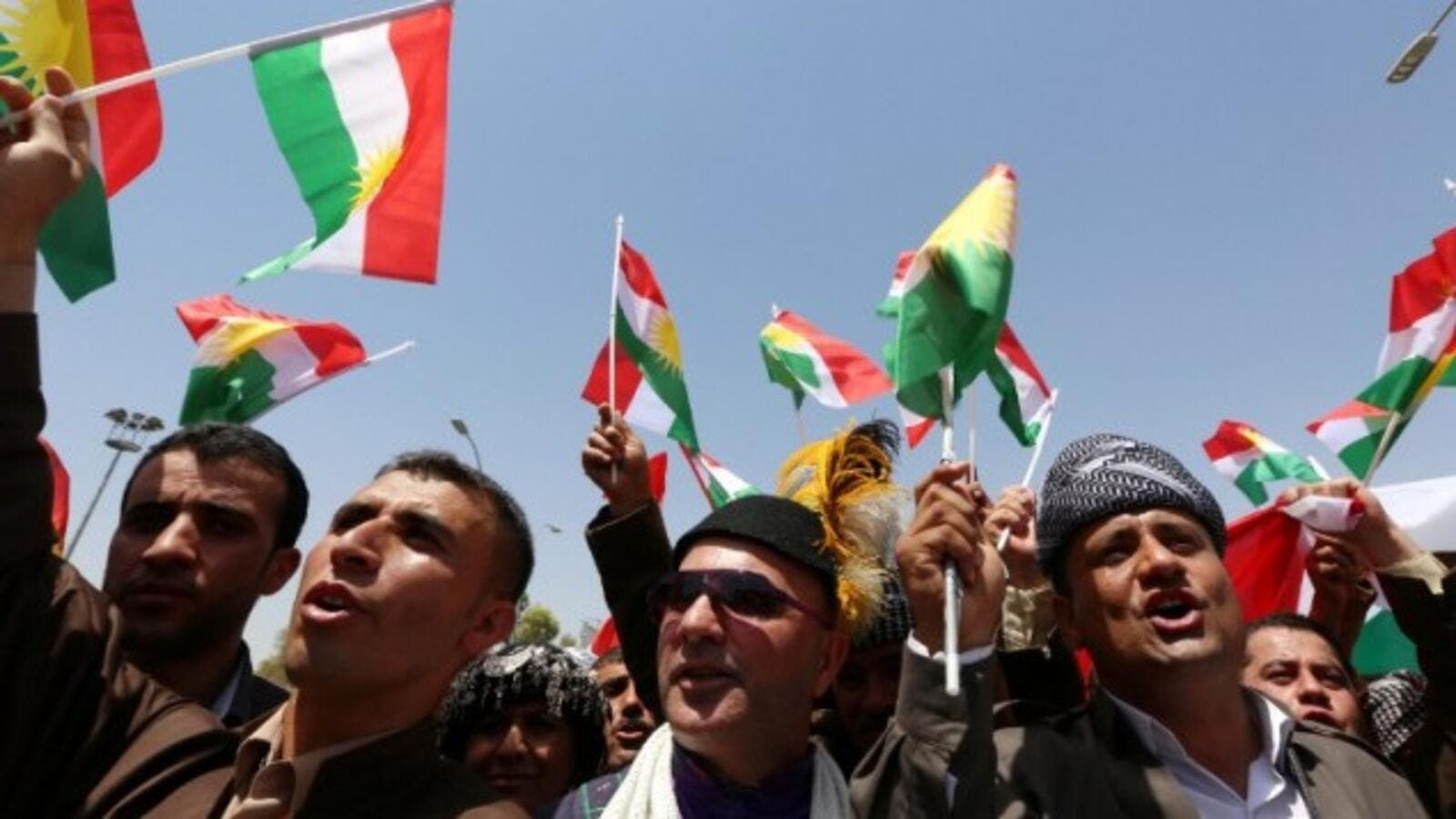 Iraqi Kurdish protesters wave flags of their autonomous Kurdistan region during a demonstration to claim for its independence. (AFP/Safin Hamed)