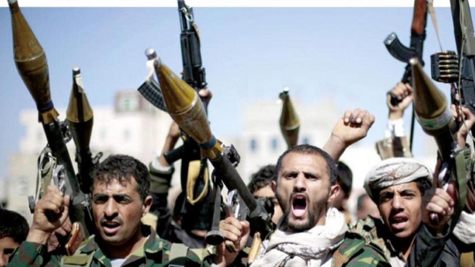 Tribesmen loyal to Houthi rebels hold their weapons in Sana'a. (AFP/ File)
