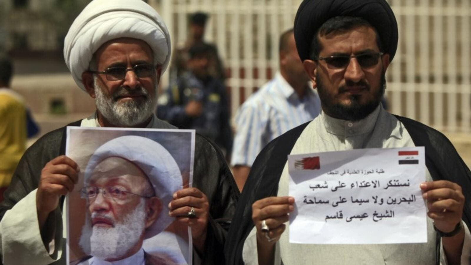 Iraqi Shiite clerics hold a picture of top Bahraini Shiite cleric Isa Qassim during a demonstration in front of the Bahraini consulate in Najaf on May 24, 2017 in solidarity with the Bahraini Shiite opposition and with the leading cleric. (Haidar Hamdani/AFP)