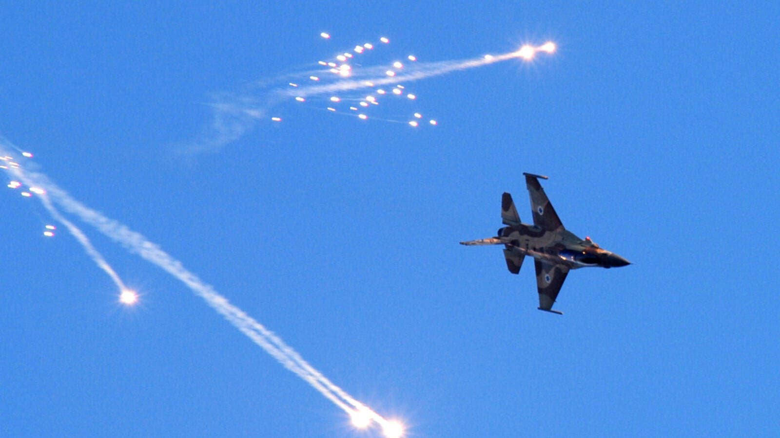Israeli warplanes have conducted many attacks on military positions in Syria's Hama province. (AFP/ File)