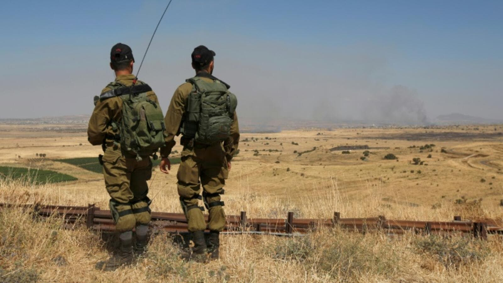 Israeli soldiers patrol near the border with Syria after projectiles fired from the war-torn country hit Israel's Golan Heights on June 24, 2017. (AFP/Jalaa Marey)
