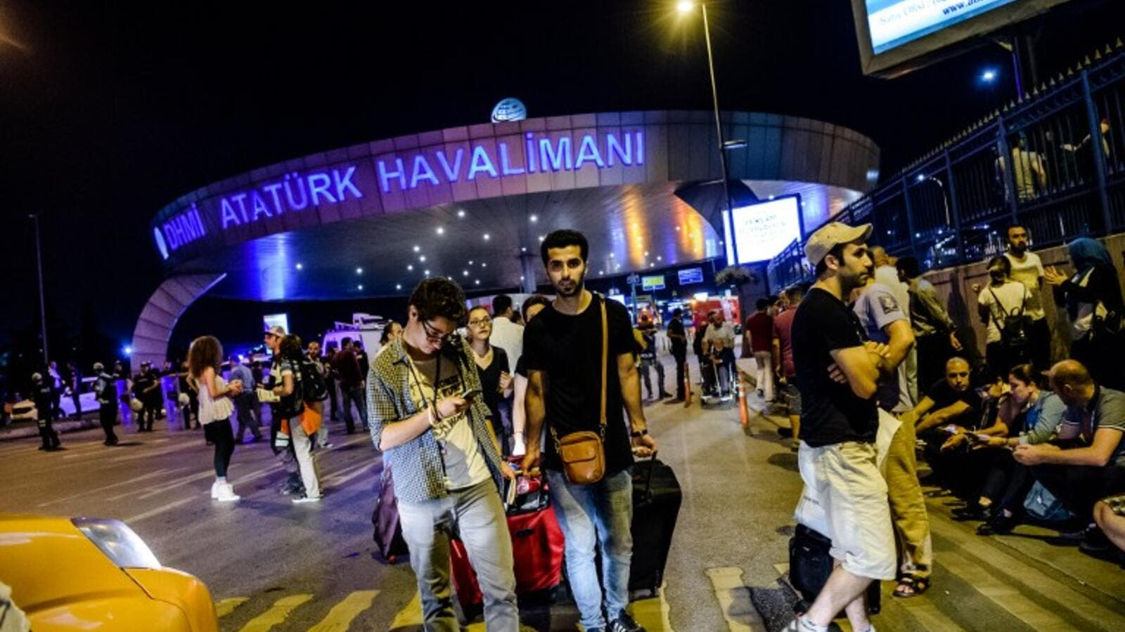 Passengers leave Ataturk airport in Istanbul on June 28, 2016 after three suicide bombers attacked. (AFP/Ozan Cose)