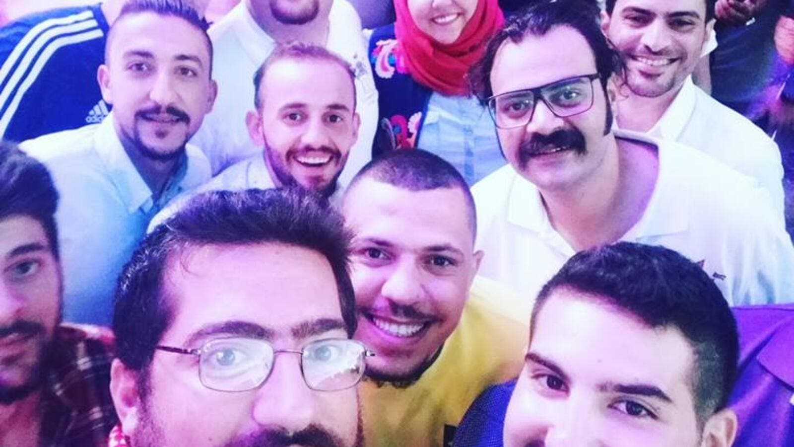 Ahmed Srour (bottom left) and other Jordanian entertainers pose for a selfie. (Facebook)