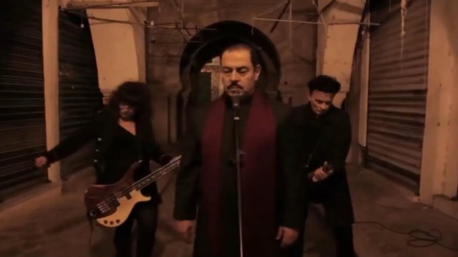 Lutfi Boshnaq (center) is the frontman for a newly formed Islamic metal band based in Tunisia. (Youtube)