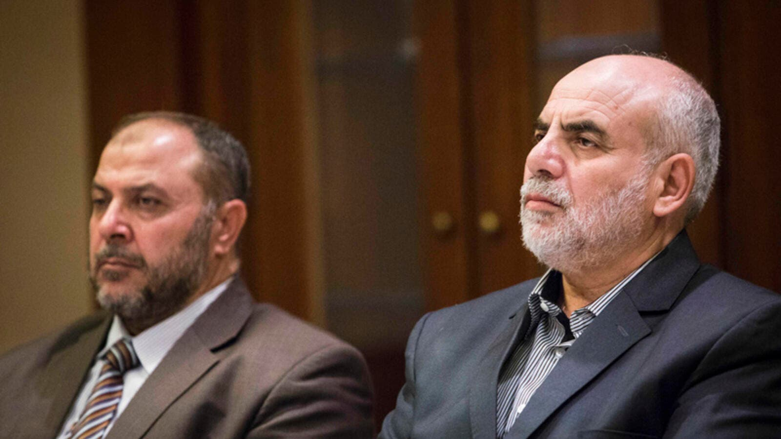 Zaki Bani Irsheid (L), former deputy of the Islamic Action Front, and Mohammad Zyoud, party chief of the Islamic Action Front, speaks during a meeting in Amman, Jordan. (Lindsey Leger)