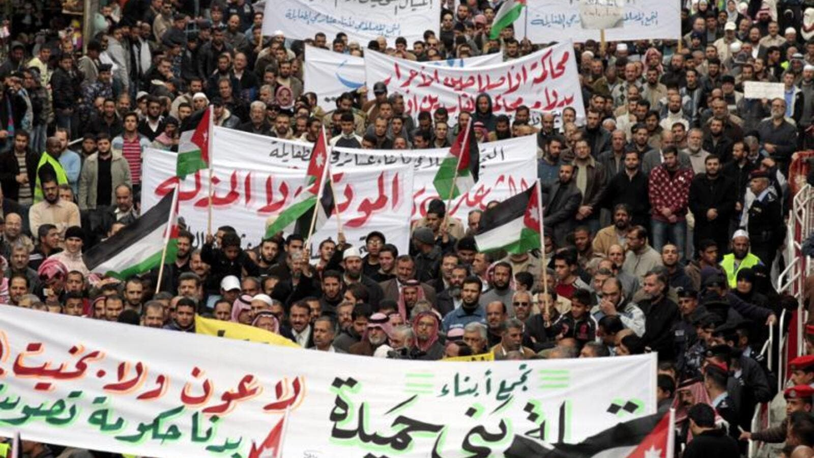Jordanian Islamic Action Front supporters shouts anti-Government slogans, in Amman, on 18 November 2011, as hundreds of Jordanian protesters mached following Friday noon prayer.