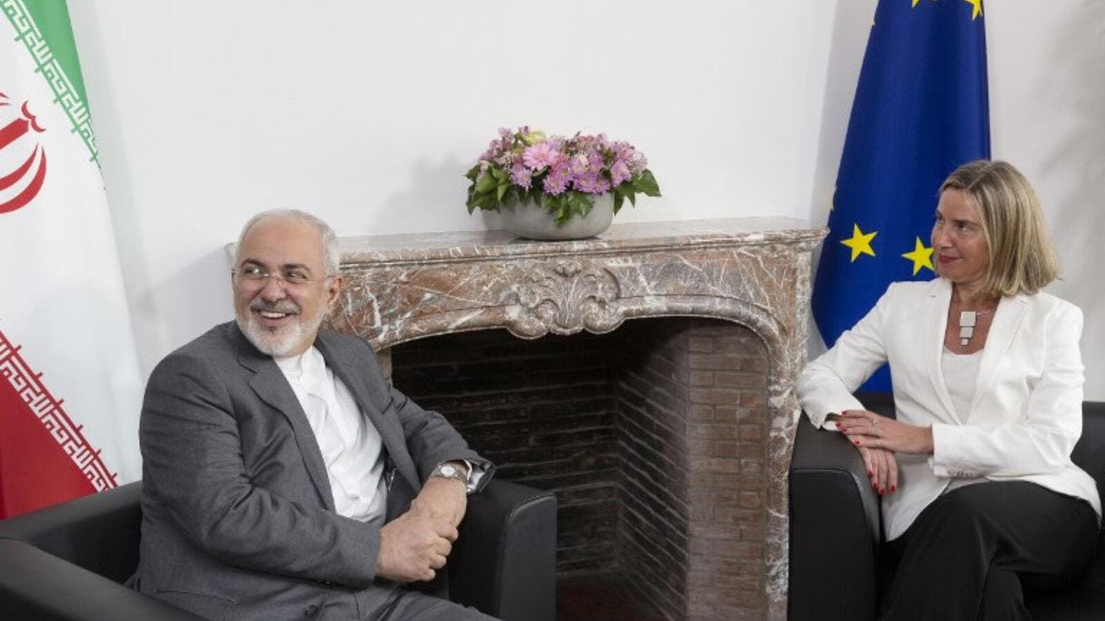Iranian Foreign Minister Mohammad Javad Zarif (L) meets with European Union Foreign Policy Chief Federica Mogherini, to discuss Iran's nuclear deal/AFP